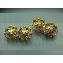 Gemelos chapados en oro
