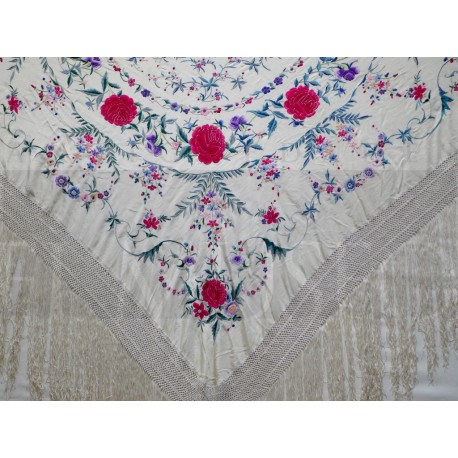Beige shawl embroidered in colours.